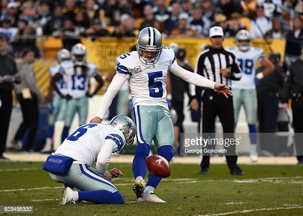 Kicker Dan Bailey of the Dallas Cowboys kicks a 37yard field goal on a hold by Chris Jones during a game against the Pittsburgh Steelers at Heinz...
