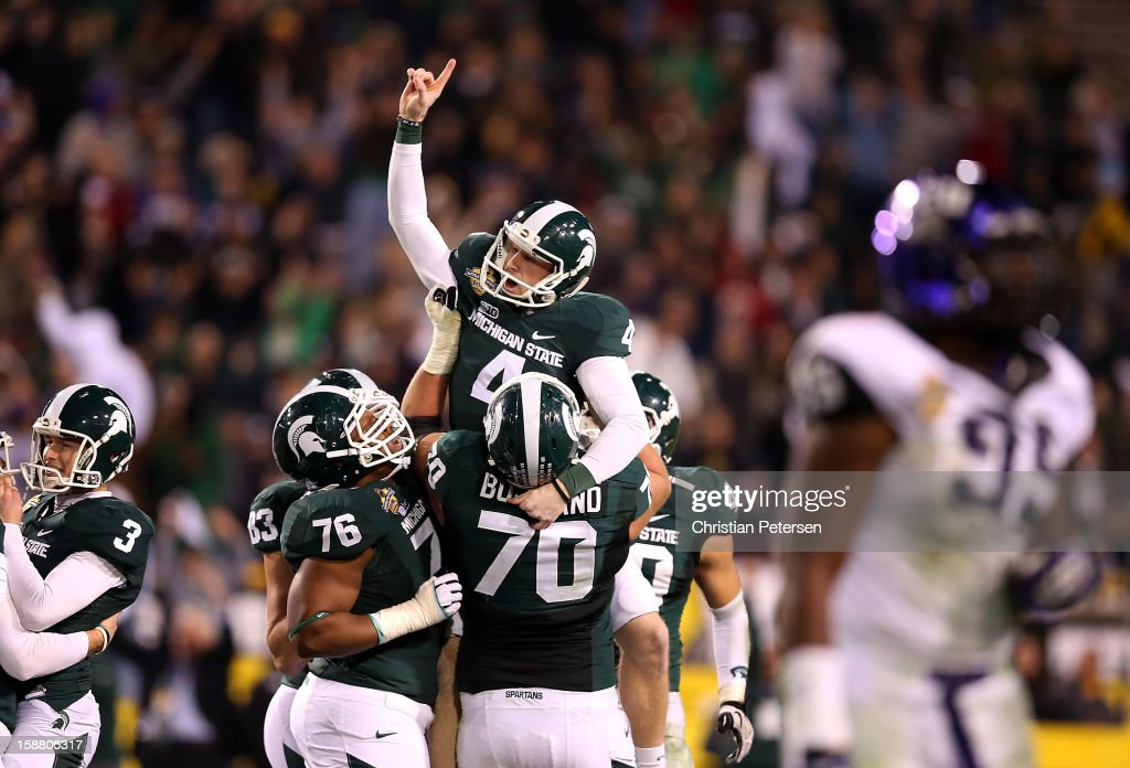 Kicker Dan Conroy #4 of the Michigan State Spartans celebrates after kicking a 47 yard field goal against the TCU Horned Frogs during the Buffalo Wild Wings Bowl at Sun Devil Stadium on December 29, 2012 in Tempe, Arizona. The Spartans defeated the Horned Frogs 17-16.
