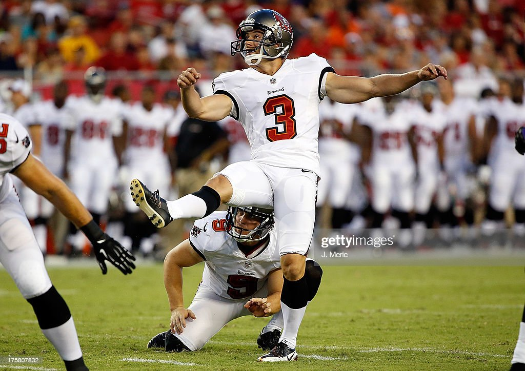 Kicker Derek Dimke #3 of the Tampa Bay Buccaneers kicks a first quarter field goal against the Baltimore Ravens during a preseason game at Raymond James Stadium on August 8, 2013 in Tampa, Florida.