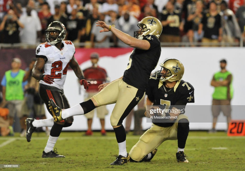 Kicker Garrett Harley #5 of the New Orleans Saints converts a game-winning 28-yard field goal in the 4th quarter against the Tampa Bay Buccaneers September 15, 2013 at Raymond James Stadium in Tampa, Florida. The Saints won 16 - 14.