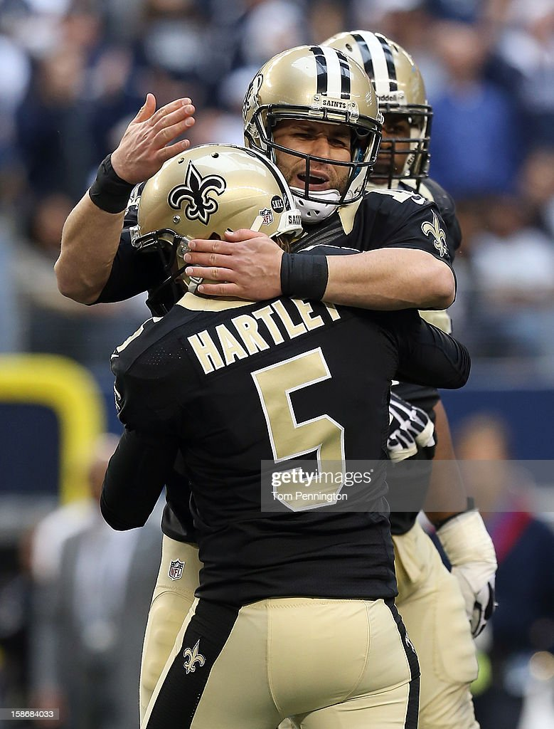Kicker <a gi-track='captionPersonalityLinkClicked' href=/galleries/search?phrase=Garrett+Hartley&family=editorial&specificpeople=4023335 ng-click='$event.stopPropagation()'>Garrett Hartley</a> #5 of the New Orleans Saints celebrates with holder <a gi-track='captionPersonalityLinkClicked' href=/galleries/search?phrase=Chase+Daniel&family=editorial&specificpeople=3977274 ng-click='$event.stopPropagation()'>Chase Daniel</a> #10 of the New Orleans Saints after Hartley kicked the game-winning field goal against the Dallas Cowboys in overtime at Cowboys Stadium on December 23, 2012 in Arlington, Texas.