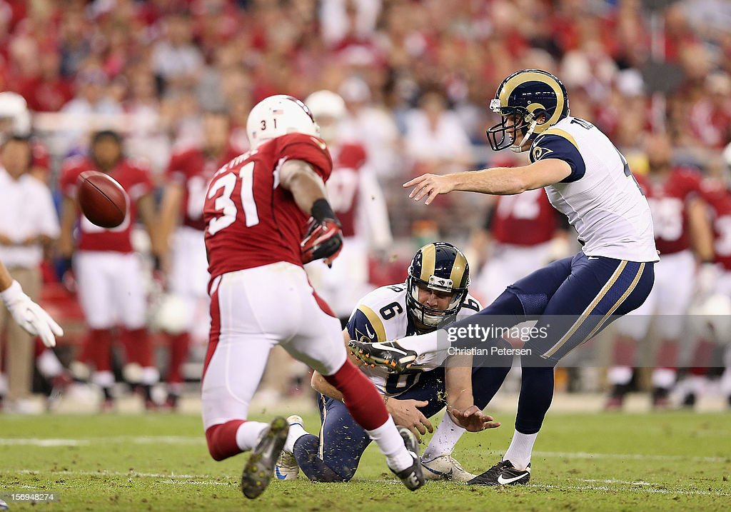 Kicker <a gi-track='captionPersonalityLinkClicked' href=/galleries/search?phrase=Greg+Zuerlein&family=editorial&specificpeople=6471802 ng-click='$event.stopPropagation()'>Greg Zuerlein</a> #4 of the St. Louis Rams attempts a field goal against the Arizona Cardinals during the third quarter of the NFL game at the University of Phoenix Stadium on November 25, 2012 in Glendale, Arizona. The Rams defeated the Cardinals 31-17.