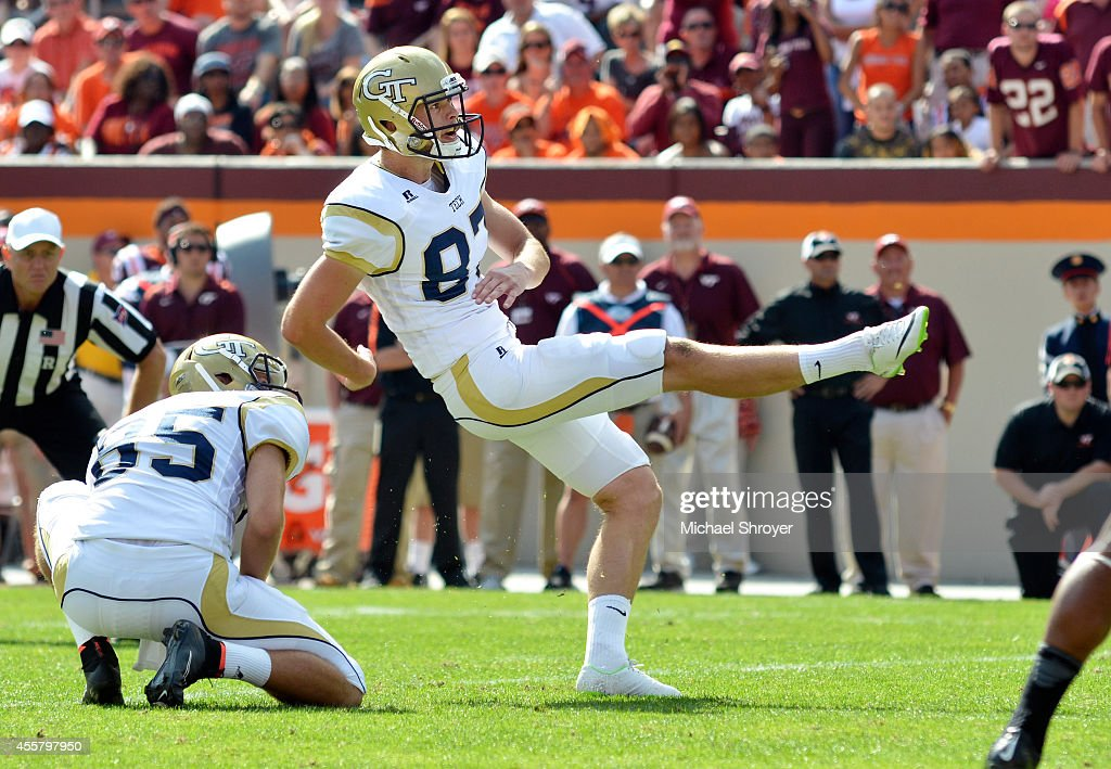 Kicker Harrison Butker #87 of the Georgia Tech Yellow Jackets watches his game winning field goal go through the uprights on the last play of the game against Virginia Tech at Lane Stadium on September 20, 2014 in Blacksburg, Virginia. Butker made the game winning field goal. Georgia Tech defeated Virginia Tech 27-24.
