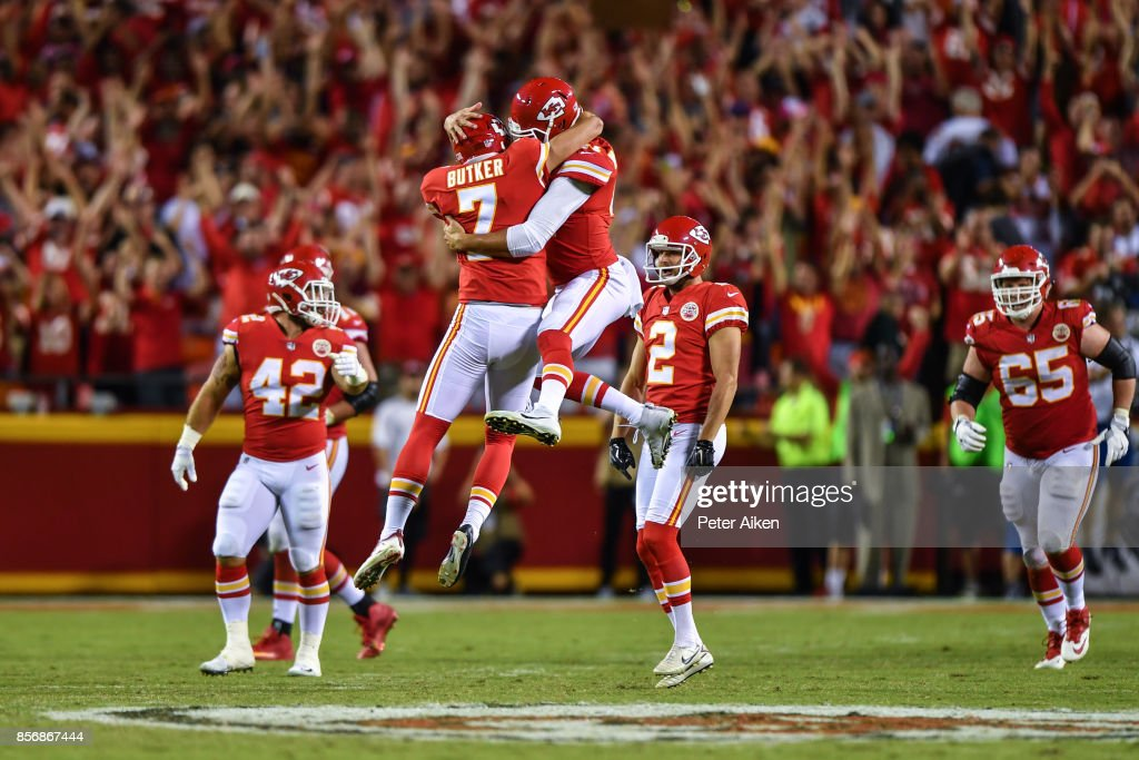Kicker Harrison Butker #7 of the Kansas City Chiefs and teammate James Winchester #41 celebrate mid air after kicking the go ahead field goal with eight seconds left during the game against the Washington Redskins at Arrowhead Stadium on October 2, 2017 in Kansas City, Missouri.