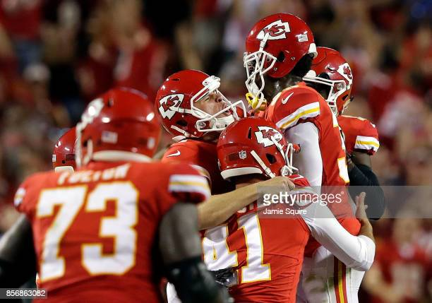 Kicker Harrison Butker of the Kansas City Chiefs is mobbed by teammates after kicking the goahead field goal with 8 seconds remaining during the 4th...