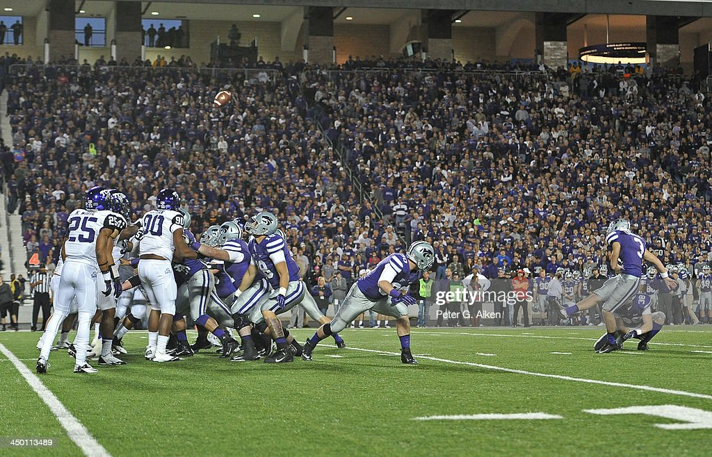 Kicker Jack Cantele #3 of the Kansas State Wildcats kicks a 23-yard field goal against the TCU Horned Frogs during the second half on November 16, 2013 at Bill Snyder Family Stadium in Manhattan, Kansas. Kansas State defeated TCU 33-31.