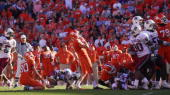 Kicker Jad Dean the Clemson Tigers watches his gametying field goal go wide during the final seconds of his team's loss to the South Carolina...