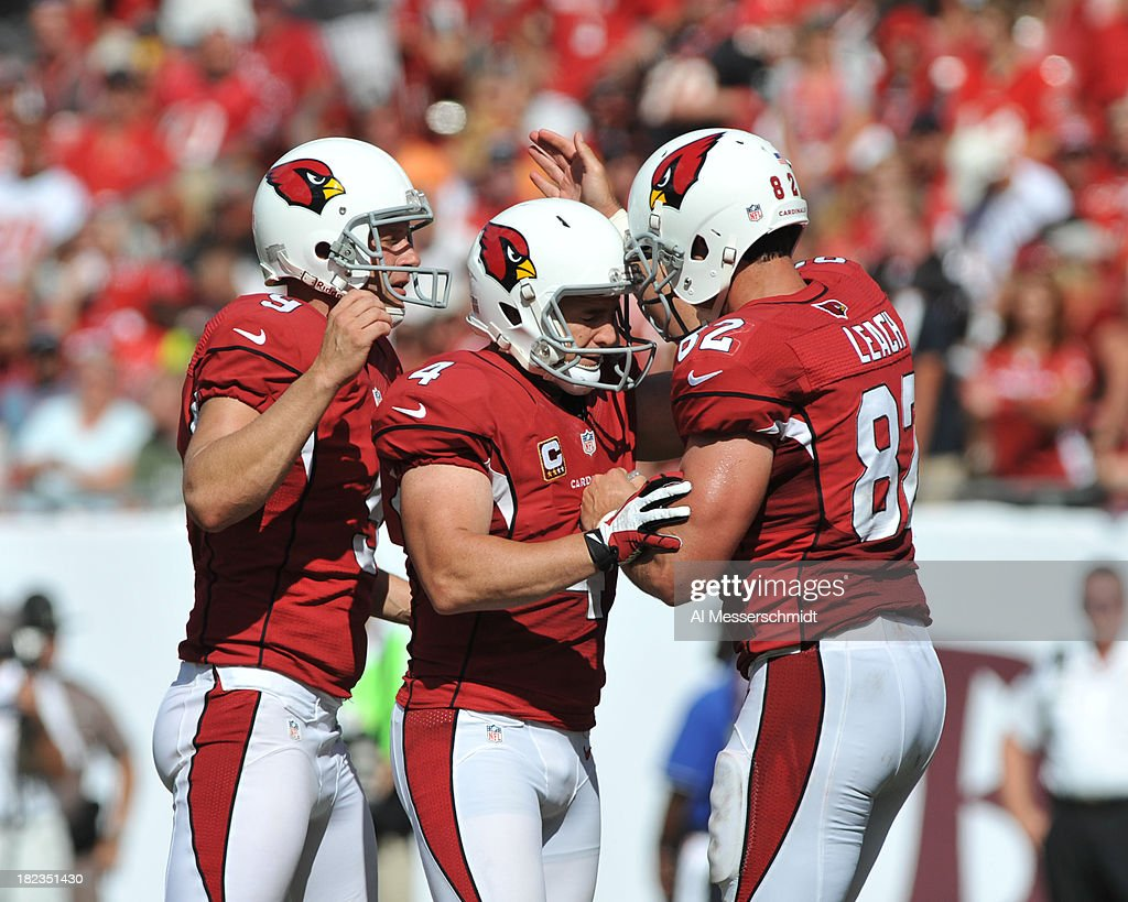 Kicker <a gi-track='captionPersonalityLinkClicked' href=/galleries/search?phrase=Jay+Feely&family=editorial&specificpeople=227839 ng-click='$event.stopPropagation()'>Jay Feely</a> #4 of the Arizona Cardinals celebrates after a 42-yard field goal in the 4th quarter against the Tampa Bay Buccaneers September 29, 2013 at Raymond James Stadium in Tampa, Florida. Arizona won 13 - 10.