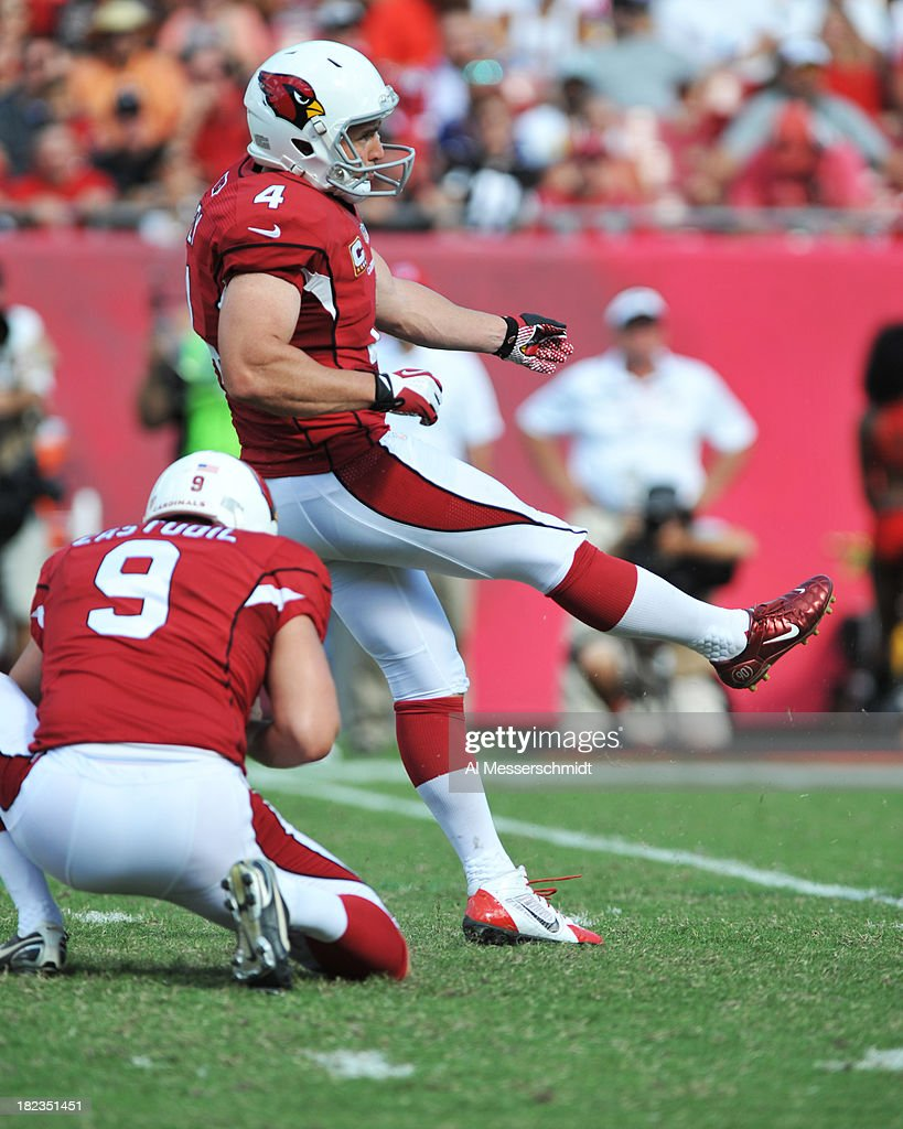 Kicker <a gi-track='captionPersonalityLinkClicked' href=/galleries/search?phrase=Jay+Feely&family=editorial&specificpeople=227839 ng-click='$event.stopPropagation()'>Jay Feely</a> #4 of the Arizona Cardinals converts a game-winning, 27-yard field goal in the 4th quarter against the Tampa Bay Buccaneers September 29, 2013 at Raymond James Stadium in Tampa, Florida. Arizona won 13 - 10.
