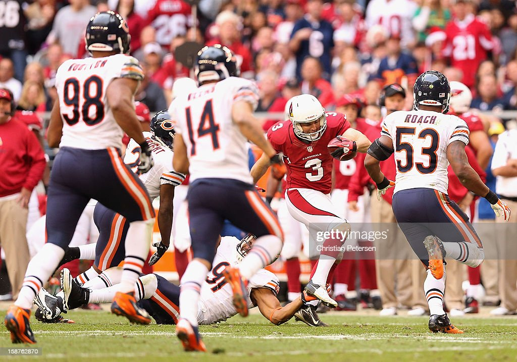 Kicker Jay Feely #3 of the Arizona Cardinals runs with the football on a fake field goal attempt during the NFL game against the Chicago Bears at the University of Phoenix Stadium on December 23, 2012 in Glendale, Arizona. The Bears defeated the Cardinals 28-13.