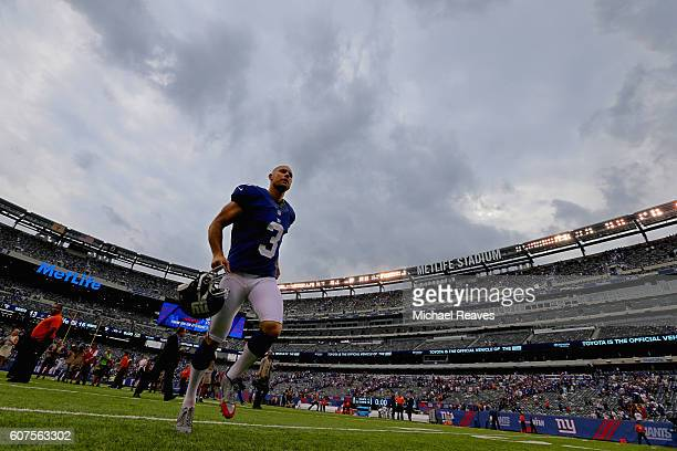 Kicker Josh Brown of the New York Giants leaves the field after kicking the gamewinning field goal against the New Orleans Saints at MetLife Stadium...