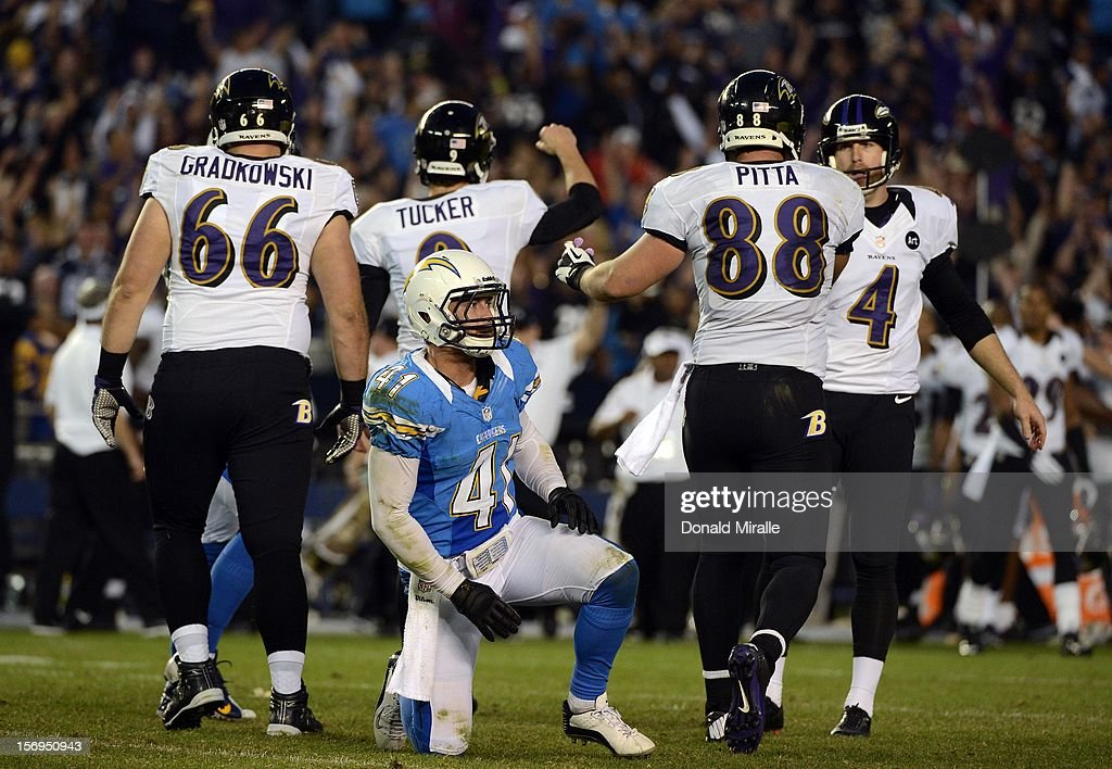 Kicker Justin Tucker #9 of Baltimore Ravens celebrates hitting the game-winning field goal as <a gi-track='captionPersonalityLinkClicked' href=/galleries/search?phrase=Corey+Lynch&family=editorial&specificpeople=5313171 ng-click='$event.stopPropagation()'>Corey Lynch</a> #41 of the San Diego Chargers looks on during the Raven's overtime for a 16-13 win over the San Diego Chargers on November 25, 2012 at Qualcomm Stadium in San Diego, California.