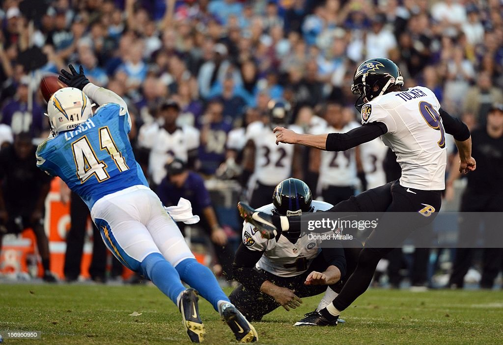 Kicker Justin Tucker #9 of Baltimore Ravens hits the game-tying field goal as <a gi-track='captionPersonalityLinkClicked' href=/galleries/search?phrase=Corey+Lynch&family=editorial&specificpeople=5313171 ng-click='$event.stopPropagation()'>Corey Lynch</a> #41 of the San Diego Chargers dives attempting to block at the end of regulations to send the game in overtime en route to the Raven's 16-13 overtime win over the San Diego Chargers on November 25, 2012 at Qualcomm Stadium in San Diego, California.
