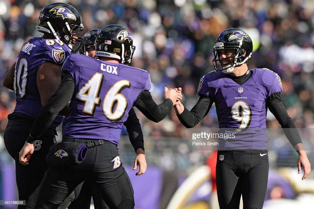 Kicker Justin Tucker of the Baltimore Ravens celebrates with long snapper Morgan Cox of the Baltimore Ravens after kicking a field goal against the...