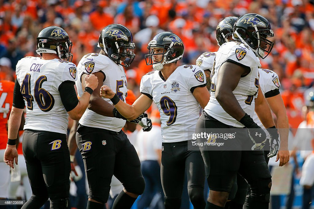 Kicker Justin Tucker of the Baltimore Ravens celebrates with Morgan Cox after scoring on a 44 yard field goal in the third quarter of a game at...