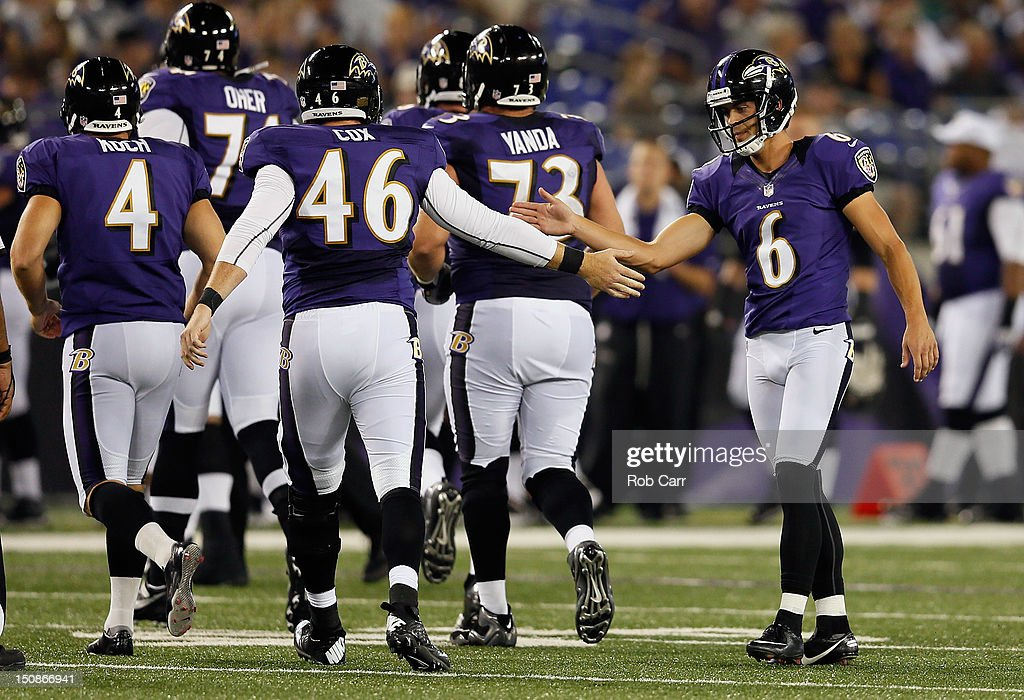 Kicker Justin Tucker of the Baltimore Ravens is congratulated by teammate Morgan Cox after kicking a field goal against the Detroit Lions at MT Bank...