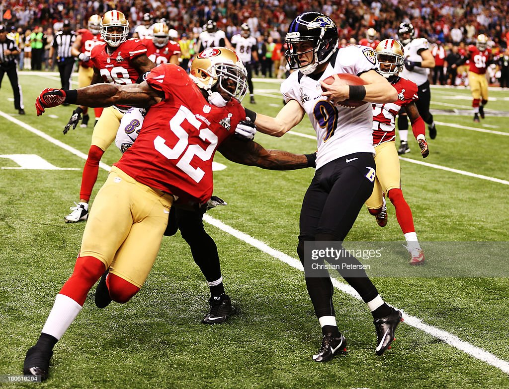 Kicker Justin Tucker #9 of the Baltimore Ravens is stopped short of a first down on a fake field goal attempt in the second quarter by Patrick Willis #52 of the San Francisco 49ers during Super Bowl XLVII at the Mercedes-Benz Superdome on February 3, 2013 in New Orleans, Louisiana.