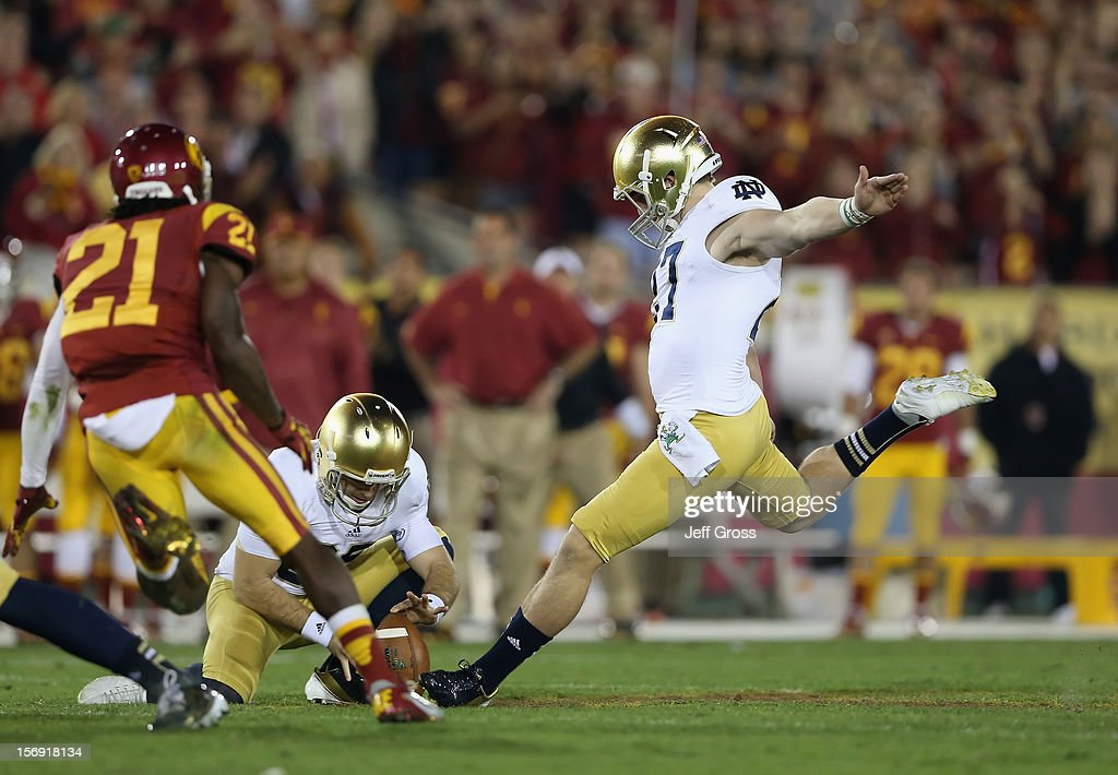 Kicker Kyle Brindza #27 of the Notre Dame Fighting Irish kicks a field goal at the end of the first half against the USC Trojans at Los Angeles Memorial Coliseum on November 24, 2012 in Los Angeles, California. Notre Dame defeated USC 22-13.