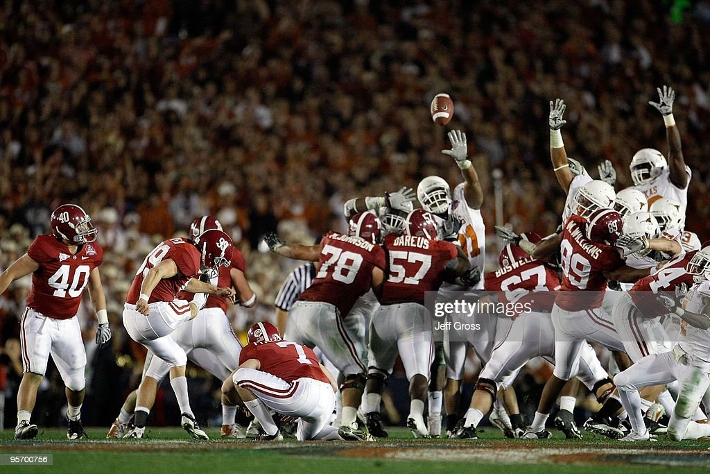 Kicker Leigh Tiffin #99 of the Alabama Crimson Tide kicks a field goal against the Texas Longhorns in the Citi BCS National Championship game at the Rose Bowl on January 7, 2010 in Pasadena, California.