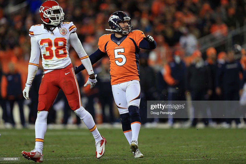Kicker Matt Prater #5 of the Denver Broncos kicks a field goal as defensive back Ron Parker #38 of the Kansas City Chiefs watches at Sports Authority Field at Mile High on November 17, 2013 in Denver, Colorado. The Broncos defeated the Chiefs 27-17.