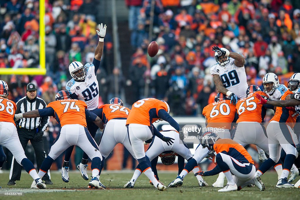 Kicker <a gi-track='captionPersonalityLinkClicked' href=/galleries/search?phrase=Matt+Prater&family=editorial&specificpeople=4408897 ng-click='$event.stopPropagation()'>Matt Prater</a> #5 of the Denver Broncos kicks a record-setting 64-yard field goal to end the second half of a game against the Tennessee Titans at Sports Authority Field Field at Mile High on December 8, 2013 in Denver, Colorado.