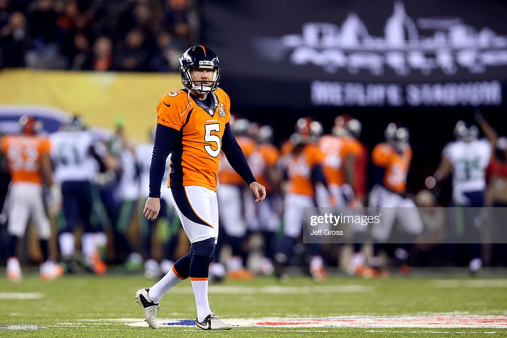 Kicker <a gi-track='captionPersonalityLinkClicked' href=/galleries/search?phrase=Matt+Prater&family=editorial&specificpeople=4408897 ng-click='$event.stopPropagation()'>Matt Prater</a> #5 of the Denver Broncos reacts after kicking the ball 52-yards for it be caught and run 87-yards by wide receiver Percy Harvin #11 of the Seattle Seahawks for a touchdown in the third quarter during Super Bowl XLVIII at MetLife Stadium on February 2, 2014 in East Rutherford, New Jersey.