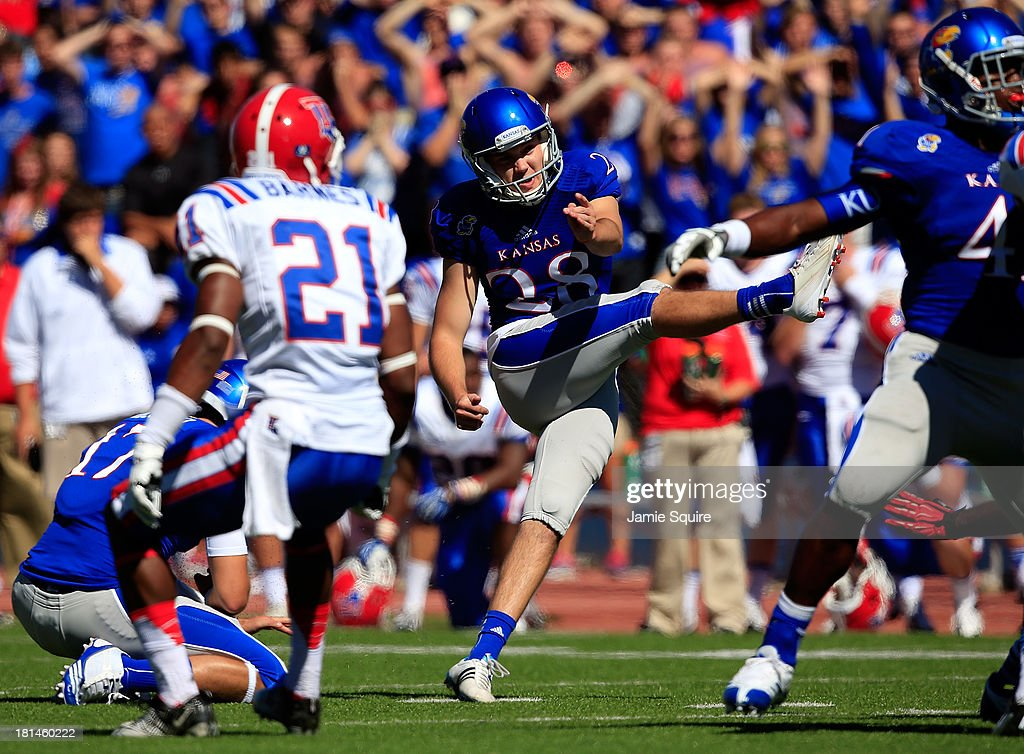 Kicker Matthew Wyman #28 of the Kansas Jayhawks kicks the game-winning field goal in the final seconds as the Jayhawks defeated the Louisiana Tech Bulldogs 13-10 turnover win the game at Memorial Stadium on September 21, 2013 in Lawrence, Kansas.