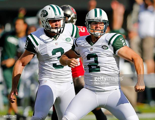 Kicker Nick Folk and punter Robert Malone of the New York Jets celebrate Folk's game winning 48 yard field goal with two seconds left in the fourth...