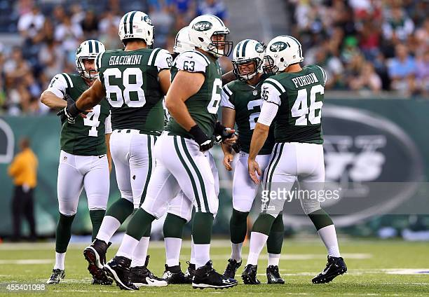 Kicker Nick Folk of the New York Jets celebrates with teammates against the Indianapolis Colts during a preseason game at MetLife Stadium on August 7...