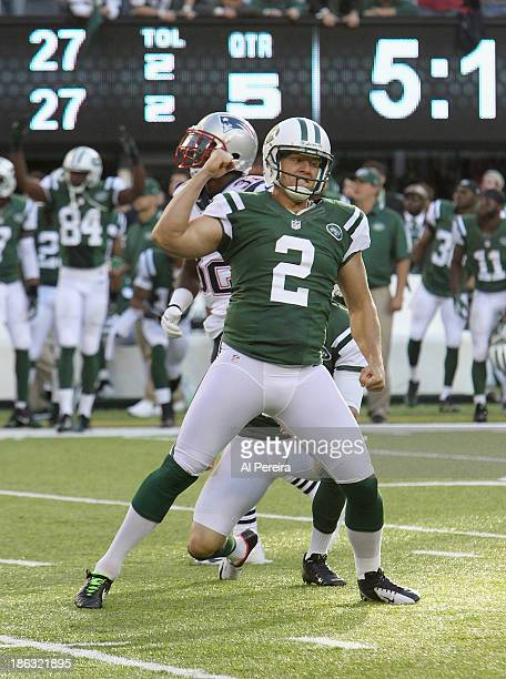 Kicker Nick Folk of the New York Jets has a GameWinning Field Goal in Overtime against the New England Patriots at MetLife Stadium on October 20 2013...