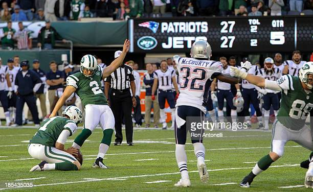 Kicker Nick Folk of the New York Jets hits the game winning field goal in overtime against the New England Patriots at MetLife Stadium on October 20...