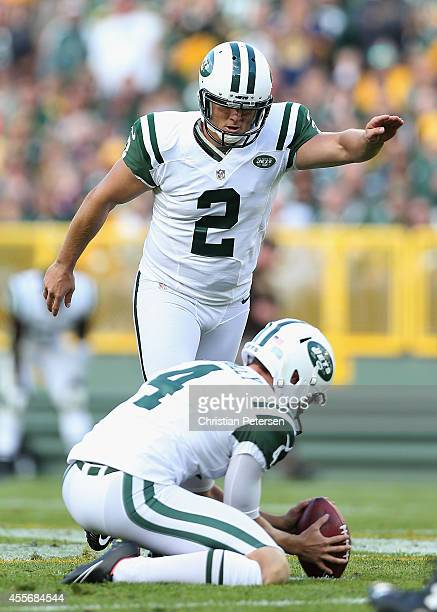 Kicker Nick Folk of the New York Jets kicks a field goal against the Green Bay Packers during the NFL game at Lambeau Field on September 14 2014 in...