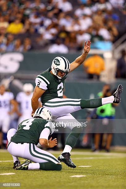 Kicker Nick Folk of the New York Jets kicks against the Indianapolis Colts during a preseason game at MetLife Stadium on August 7 2014 in East...