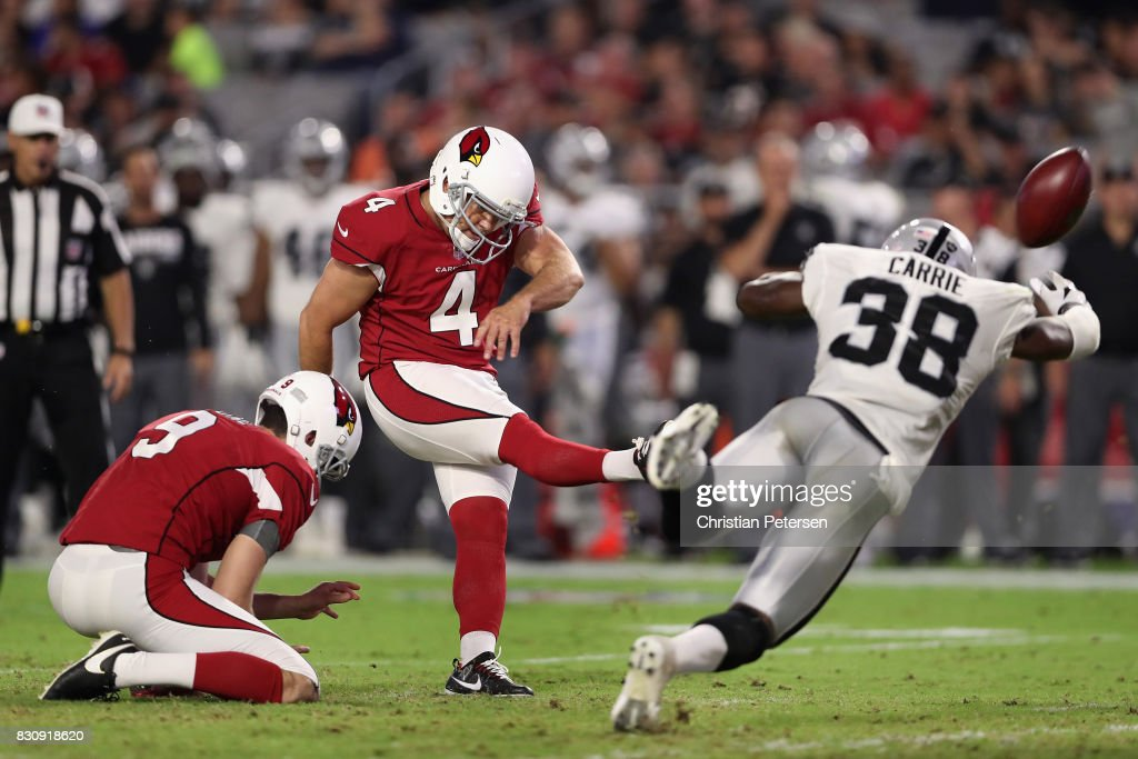 Kicker Phil Dawson #4 of the Arizona Cardinals kicks a 43 yard field goal past strong safety T.J. Carrie #38 of the Oakland Raiders during the second half of the NFL game at the University of Phoenix Stadium on August 12, 2017 in Glendale, Arizona.