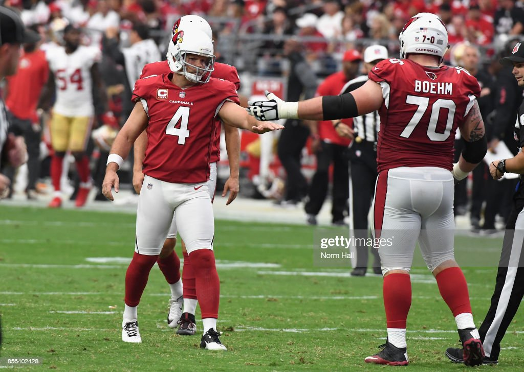 Kicker Phil Dawson #4 of the Arizona Cardinals reacts with teammate offensive guard Evan Boehm #70 after kicking a second quarter field goal during the NFL game against the San Francisco 49ers at the University of Phoenix Stadium on October 1, 2017 in Glendale, Arizona.