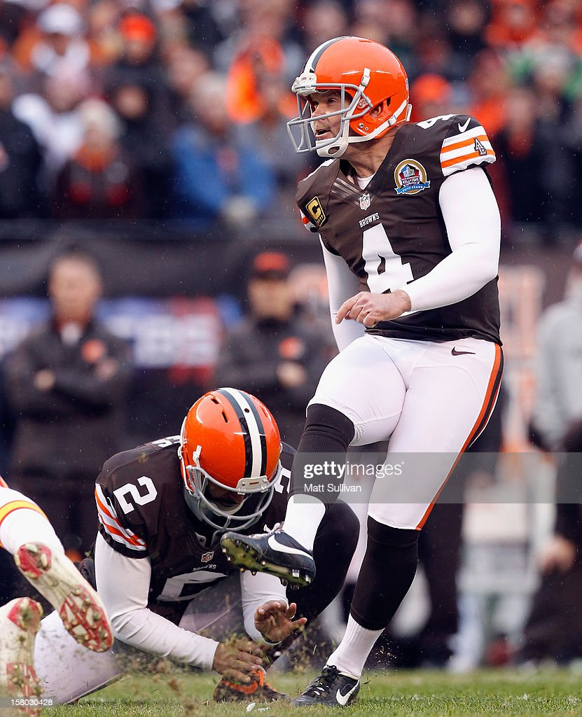 Kicker Phil Dawson #4 of the Cleveland Browns kicks his 300th career field goal as punter Reggie Hodges #2 holds against the Kansas City Chiefs at Cleveland Browns Stadium on December 9, 2012 in Cleveland, Ohio.