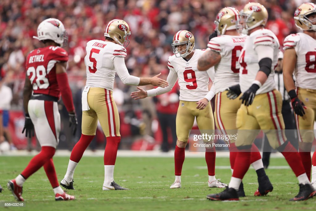 cb62e511f2f ... Elite White Jersey Kicker Robbie Gould 9 of the San Francisco 49ers  reacts with punter Bradley Pinion