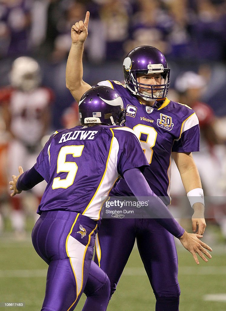 Kicker Ryan Longwell #8 and holder Chris Kluwe #5 of the Minnesota Vikings celebrate their game winning field goal in overtime against the Arizona Cardinals at Hubert H. Humphrey Metrodome on November 7, 2010 in Minneapolis, Minnesota. The Vikings won 27-24 in overtime.