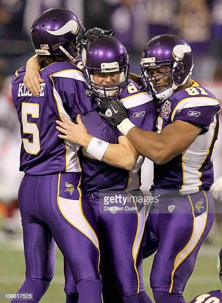 Kicker Ryan Longwell holder Chris Kluwe and receiver Visanthe Shiancoe of the Minnesota Vikings celebrate their game winning field goal in overtime...