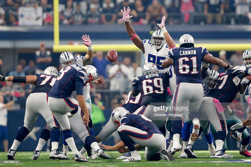 Kicker Stephen Gostkowski #3 of the New England Patriots kicks a 57 yard field goal against the Dallas Cowboys during the first half of the NFL game at AT&T Stadium on October 11, 2015 in Arlington, Texas.