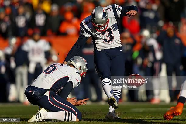 Kicker Stephen Gostkowski of the New England Patriots kicks a first quarter 45yard field goal against the Denver Broncos as punter Ryan Allen holds...