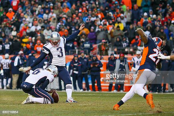 kicker Stephen Gostkowski of the New England Patriots kicks a third quarter 40yard field goal against the Denver Broncos as punter Ryan Allen of the...