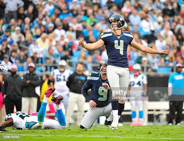 Kicker Steven Hauschka and holder Jon Ryan of the Seattle Seahawks watch Hauschka's field goal attempt during a game against the Carolina Panthers at...