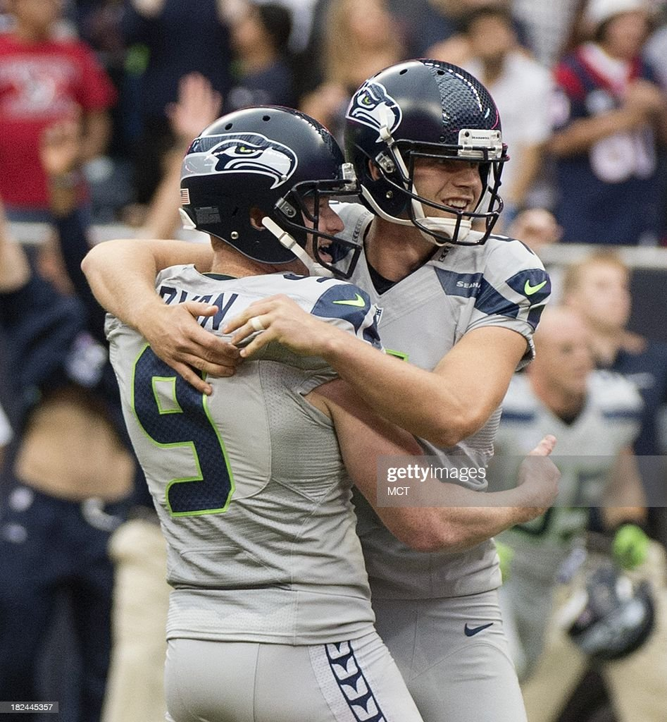 Kicker Steven Hauschka (4) and holder Jon Ryan (9) of the Seattle Seahawks celebrate his game-winning field goal in a 23-20 overtime loss to the Seattle Seahawks on Sunday, September 29, 2013, in Houston, Texas.