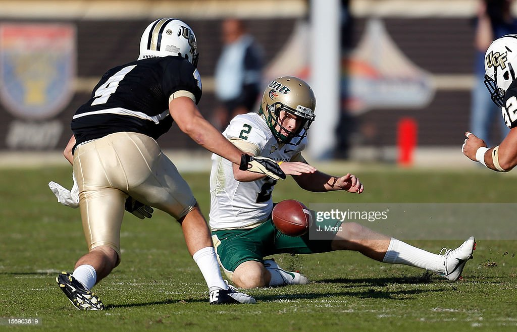 Kicker Ty Long #2 of the Alabama Birmingham Blazers recovers an onside kick against the Central Florida Knights during the game at Bright House Networks Stadium on November 24, 2012 in Orlando, Florida.