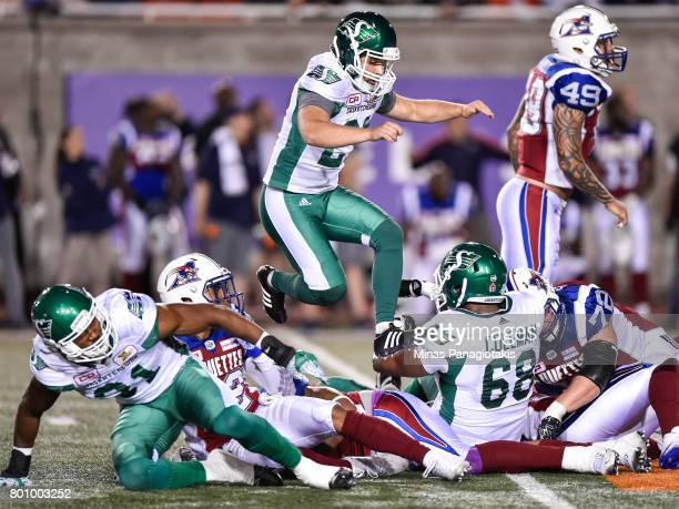 Kicker Tyler Crapigna of the Saskatchewan Roughriders jumps over a group of players in the second half against the Montreal Alouettes during the CFL...