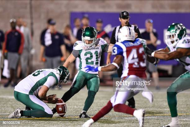 Kicker Tyler Crapigna of the Saskatchewan Roughriders prepares to kick the ball against the Montreal Alouettes during the CFL game at Percival Molson...
