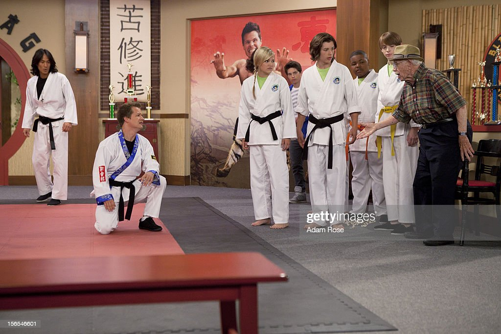 KICKIN' IT - 'Kickin' It On Our Own – Part 1 and 2' - When Rudy's uncle Blake (played by George Wendt) offers him a high profile job at his chain of amusement parks, Rudy quits the dojo and Bobby Wasabi sells it to Ty and the Black Dragons. After Ty downgrades the Wasabi Warriors to white belts, they all decide to leave the dojo and go their separate ways. When Rudy calls the gang together for dinner to make a big announcement, he discovers the truth and decides to win back his dojo via a tournament with Ty and the Black Dragons. Milton enlists the help of his Aunt Jillian (played by Jillian Michaels) to get them back in shape for the tournament, but, Ty brings in a ringer, WWE star Kofi Kingston, to go up against Rudy, in a new episode of 'Kickin' It,' MONDAY, NOVEMBER 19 (8:00-9:00 p.m., ET/PT) on Disney XD. GERSHENZ