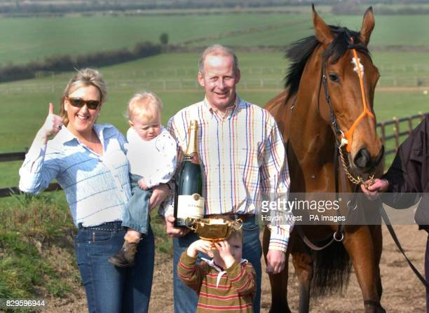 Kicking King winner of the Cheltenham Gold Cup with Tom Taaffe's wife Elaine baby Alex trainer Tom Taaffe and son Pat
