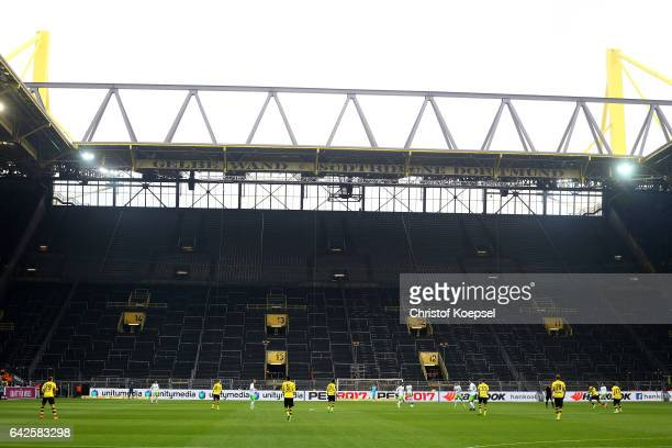 Kickoff in front of the empty south tribune prior to the Bundesliga match between Borussia Dortmund and VfL Wolfsburg at Signal Iduna Park on...